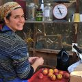 woman working with apples in the summer kitchen